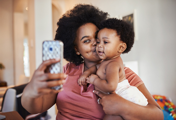 Cropped shot of a young woman taking a selfie with her baby girl